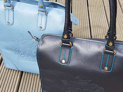 Handmade leather holdalls