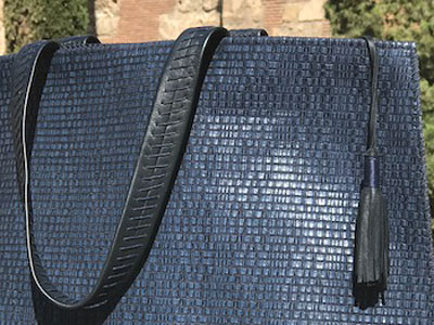 Hand-woven leather holdall